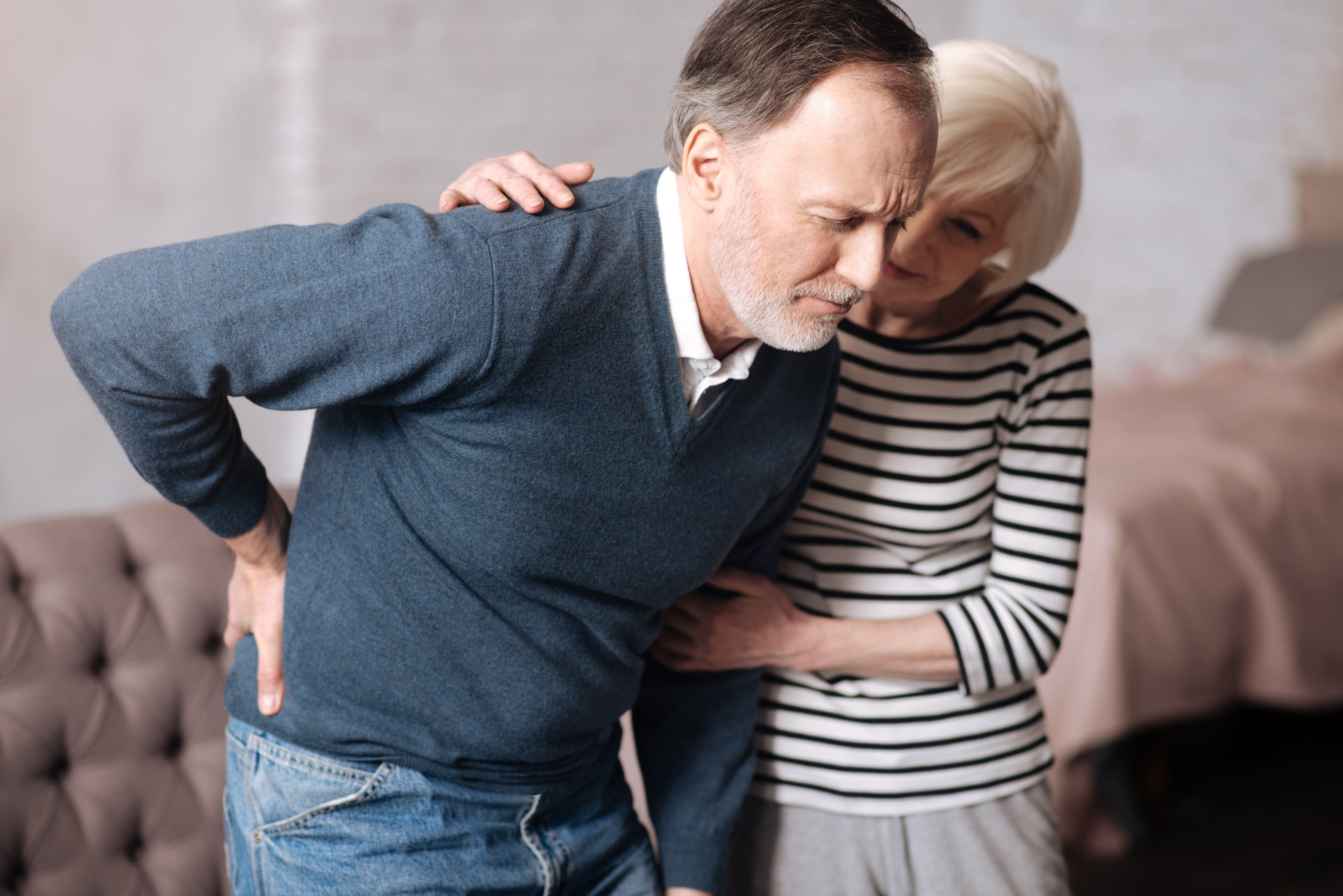 Woman-Helping-Man-with-Back-Pain